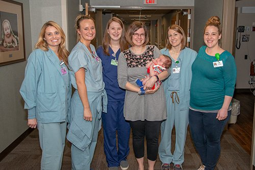 Pictured from left to right are: Kristen Senjem, RN; Heather DeJong, RN; Miranda DeLarm, RN; Karen Edgington, Heinrik Edgington, Dr. Beth Soulli, Dr. Alia Thomas