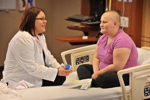 Pharmacist Jill Bode consults with cancer patient Macy Owen before she is discharged from Mary Greeley.