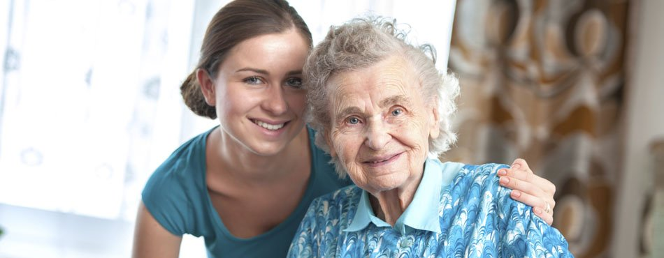 Photo of elderly woman with nurse.