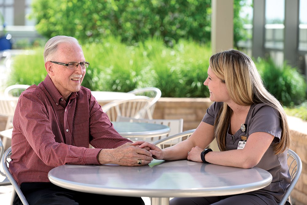 Larry Northup and Whitney Garwood, radiation oncology supervisor, share a moment on Mary Greeley's garden patio. After receiving outstanding care during cancer treatment, Larry began volunteering in radiation oncology and provided support for an education fund for department staff.