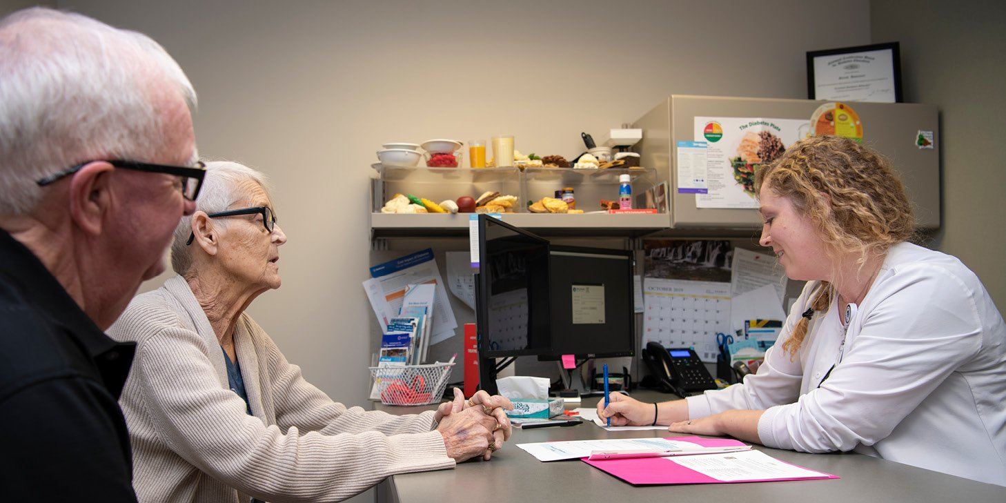 Kelly Flater, Dietitian at Mary Greeley's Diabetes and Nutrition Education Center works with two people on their nutritional needs.