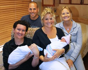 Ian and Jamie Wolds hold the twins as they share a moment with Bryon and Staci Mason in one of Birthways rooms.