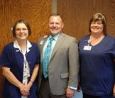 CFO Gary Botine presents Grateful Patient Award to Deb West and Amy McCormick.
